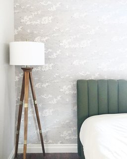 Rose installed wallpaper, adding some texture to the otherwise minimalist space.
