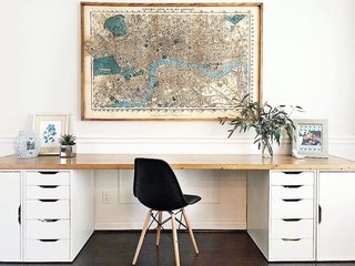 Rose placed a custom 10-foot-long wood top over IKEA Alex drawers to create an extra large desk with storage.