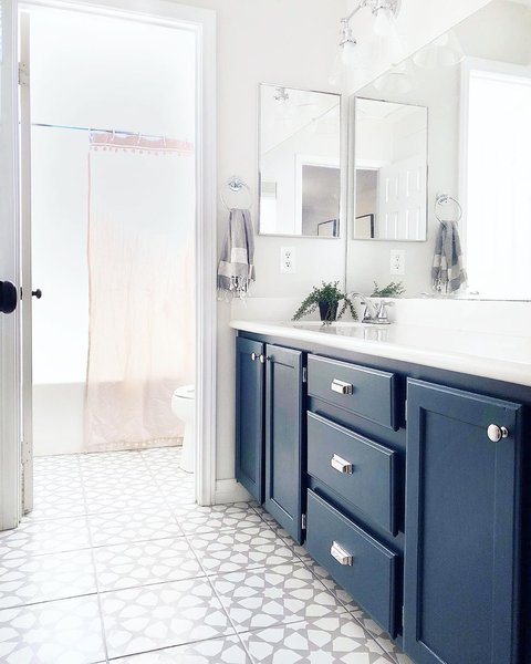 Rose stenciled her bathroom tile with a pattern from Dizzy Duck Designs on Etsy.