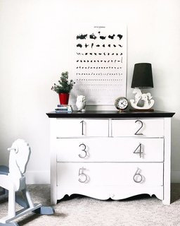 Conklin updated a dresser with house numbers for knobs. Her two-year-old helps put his clothes away by figuring out which number they go behind.