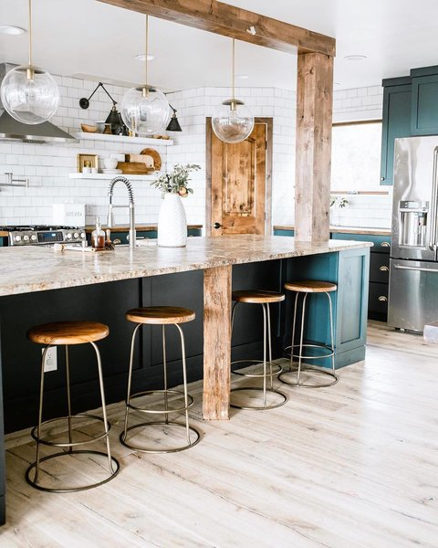 Holman's kitchen blends textures and rich hues with Waltz counter stools from McGee & Co and a Luna pendant from Schoolhouse.
