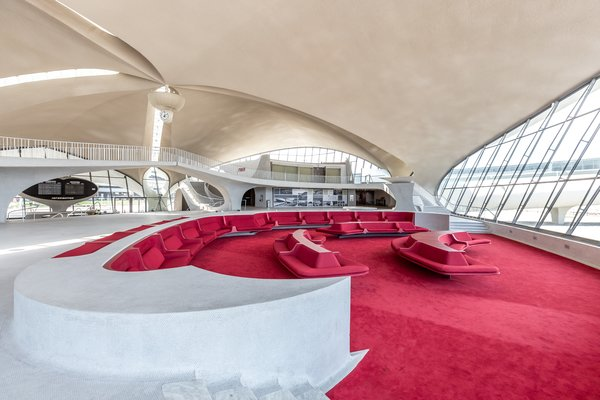 Curved seating banquettes and Eero Saarinen-designed penny tile flooring make up the main common areas of the TWA Hotel.