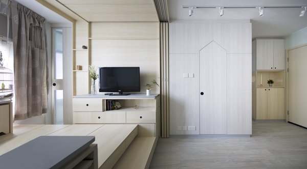 The tiny apartment is filled with clever space-saving solutions, including built-in storage and transforming furniture.