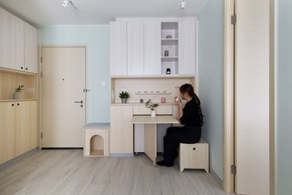 The dining area unfolds from a cabinet.