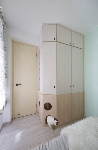 The mother's bedroom cabinet holds a built-in cat house.