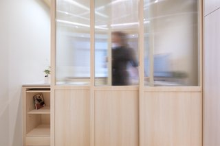 Sliding fritted glass doors provide privacy and sectioned-off spaces when needed.