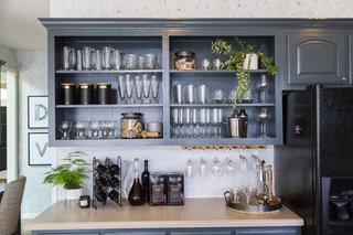 Open shelving provides a rustic touch and a place to store some of the family's beautiful kitchenware.