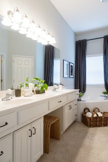 A streamlined bathroom makes getting ready easy and provides a space for Elrod to decompress.