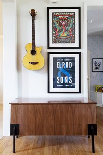 Personalized wall decor adds artistic intricacy to this nook.