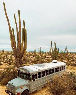 Their 34-foot-long bus in Joshua Tree.