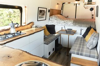 The view of the sitting area and bed from the sink.