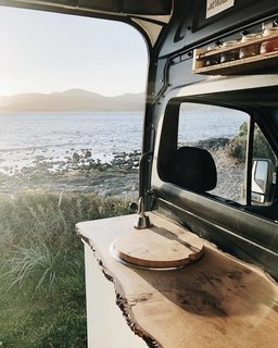 A live edge counter adds a warm, inviting feel to the van.