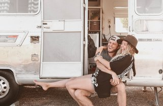 The Armstrongs cuddled up in front of their Airstream.