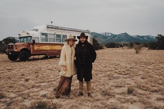 Jeffrey and Britt in front of their bus.