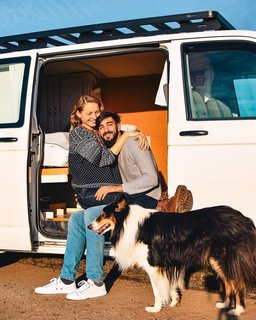 The lovebirds and Cleo in front of the van.