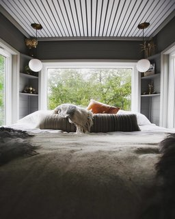 The bedroom is immersed in views.