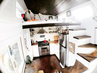 A view of the kitchen and sleeping loft.