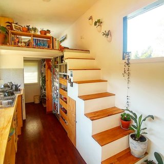 A view of the stairs and kitchen.