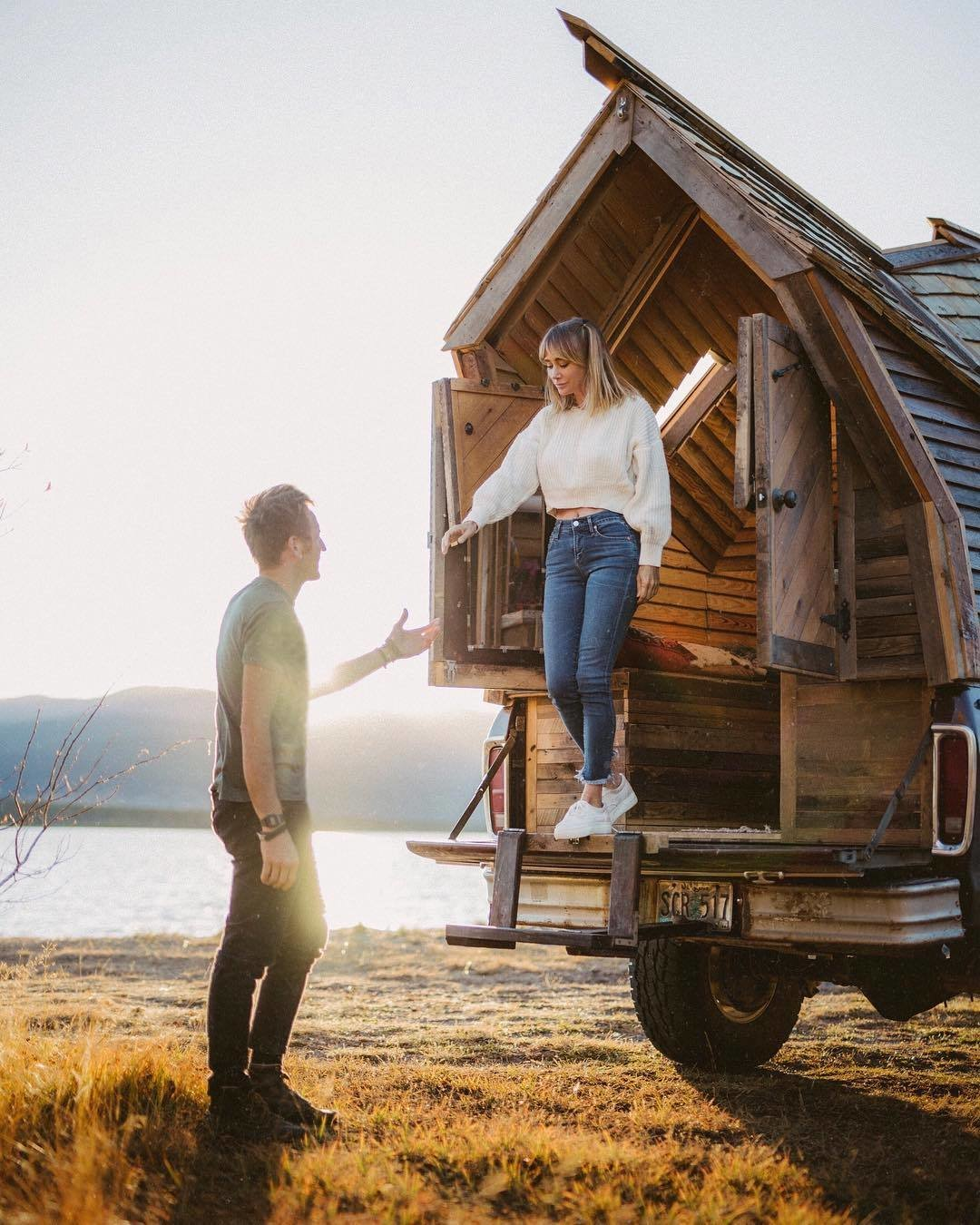 Exterior, Wood Siding Material, Shingles Roof Material, Tiny Home Building Type, A-Frame RoofLine, Cabin Building Type, and Camper Building Type Witzling and Underwood stepping out of the truck cabin.  Best Photos from 10 Tiny Home Dwellers You Should Follow on Instagram Right Now