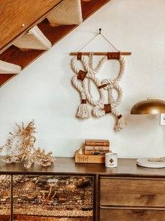 Thomas pairs handmade goods with antique and natural elements to instill a cozy, yet artsy aesthetic.