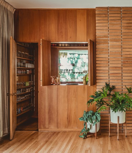 To Claire Thomas, it was a perfect time capsule with wood-clad walls, a hidden bar, room dividers, and a chrome-edged streamlined kitchen.