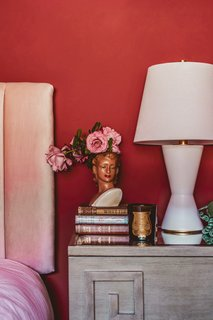 Thomas creates a thoughtful vignette on the guest room nightstand.