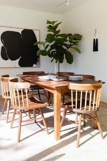 The dining room is a minimalist space with handmade Shigouri dining chairs from Guest House.