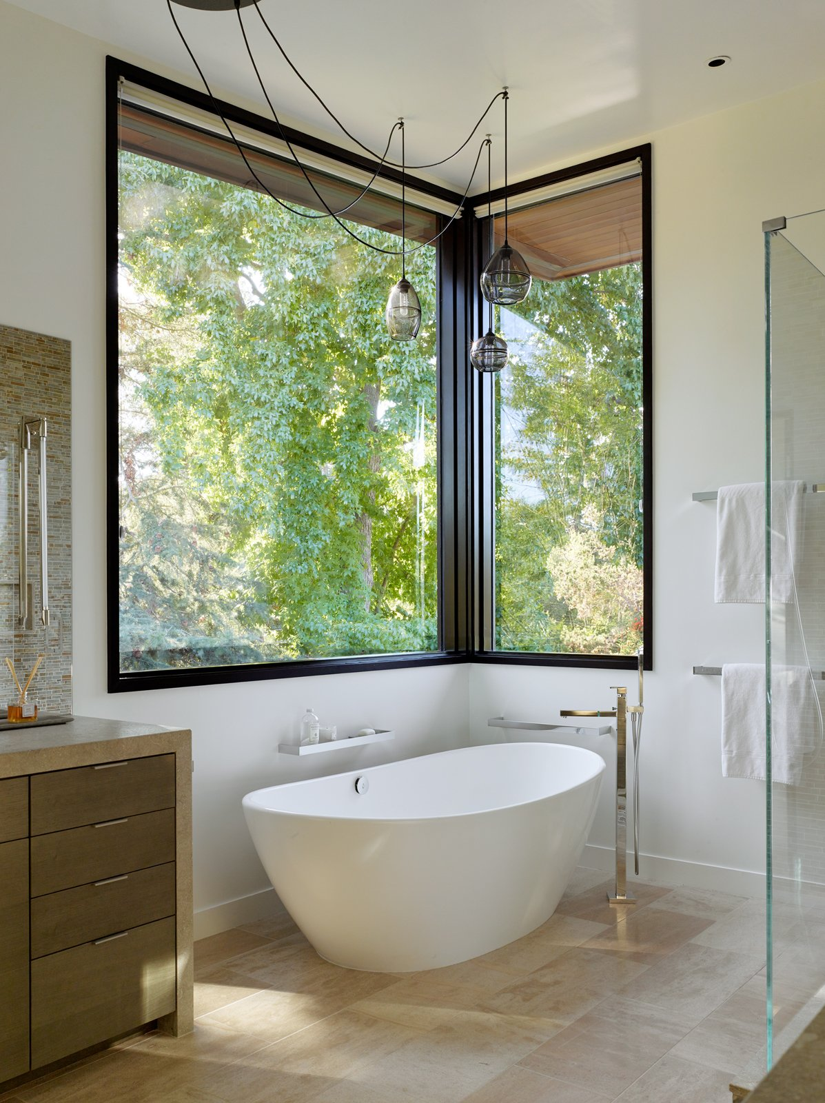 Bath, Stone, Ceiling, Freestanding, Enclosed, Drop In, Soaking, and Ceramic Tile A standalone soaking tub offers respite at the end of a long day.  Bath Freestanding Stone Photos from A Silicon Valley Retreat Sports a Butterfly Roof and Two Indoor/Outdoor Wings