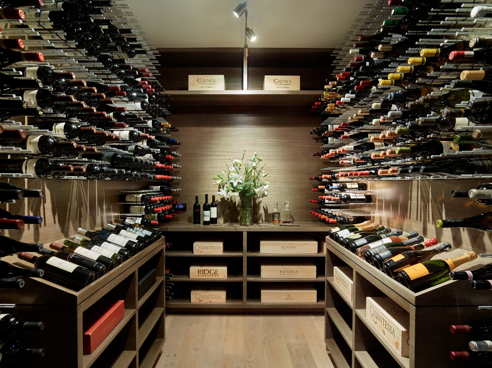 Storage Room An entertainer's delight, an entire wine room offers storage for their favorite bottles.  Photo 9 of 13 in A Silicon Valley Retreat Sports a Butterfly Roof and Two Indoor/Outdoor Wings