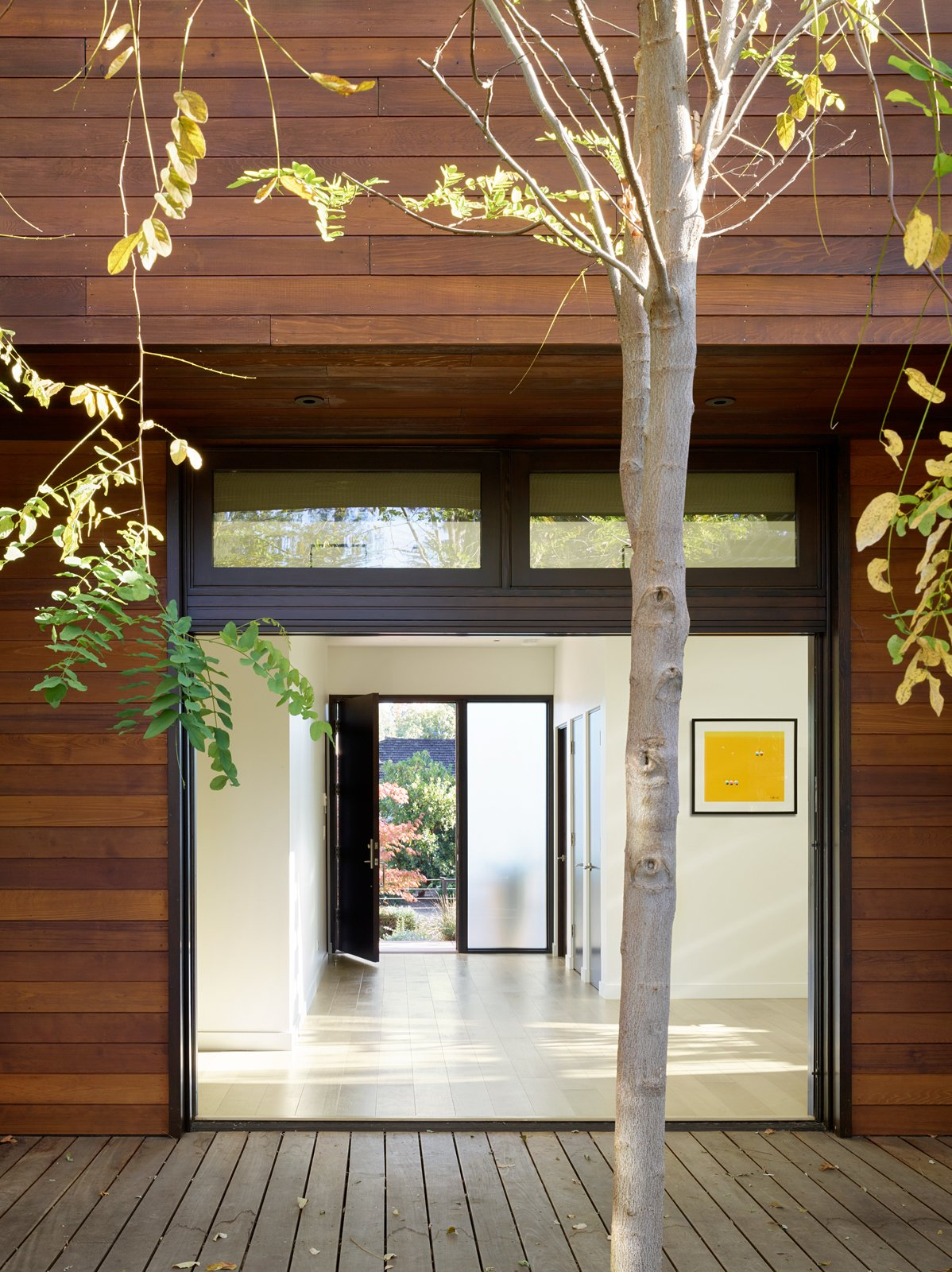 Exterior, Butterfly RoofLine, Wood Siding Material, and House Building Type A view into the entry gallery from the courtyard.  Photo 13 of 13 in A Silicon Valley Retreat Sports a Butterfly Roof and Two Indoor/Outdoor Wings
