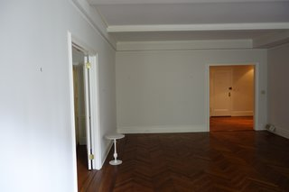 The living room was once a large, open space with no separation.
