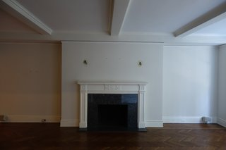 The antiquated fireplace didn't make for much of a focal point.