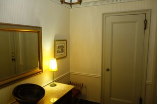 The hallway felt like an outdated hotel room with muted colors, textures, and decor.