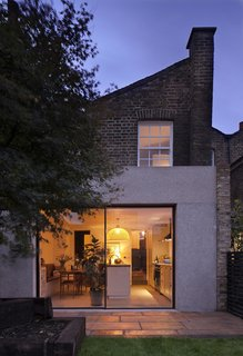 A Concrete Addition Caps a Photographer's Georgian-Style Home in London