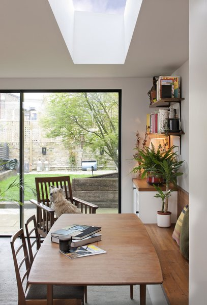 A skylight over the dining table creates an inviting gathering space. Furniture was sourced from London's Two Columbia Road.