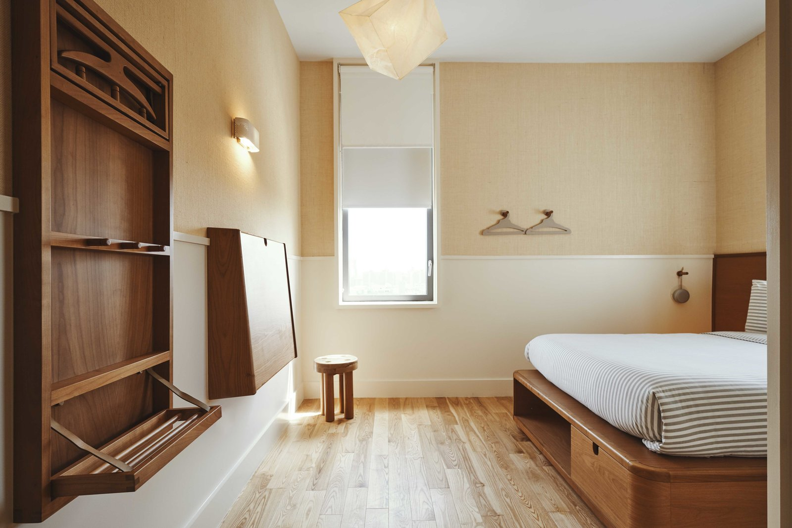 Bedroom, Wall, Bed, Wardrobe, Lamps, Ceiling, Night Stands, Light Hardwood, and Pendant The rooms exude clean lines with all built in furniture aside for a stool.  Best Bedroom Wardrobe Bed Wall Photos from Ace Hotel's Sister City Opens in New York—and it's a Beaut