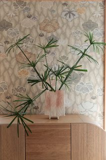 Muted, floral wallpaper adorns the walls.
