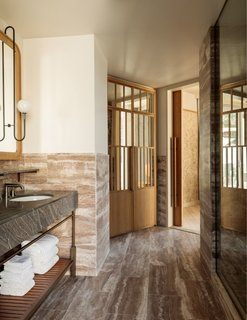 The Zen-like bathrooms are cloaked in stone and wood.