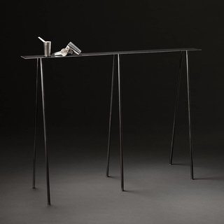 The small version of UMÉ Studio's Paper Table series in stained black with their Sake Tampo.