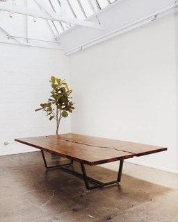 A claro walnut split slab table by Gong.