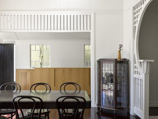 Intricate trim and paneling on the walls exude Queenslander style.
