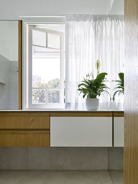 Clean lines and organic hues permeate the bathroom.