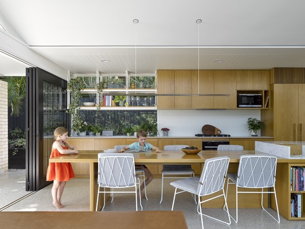 Doors in the kitchen open up the space to the outdoors.