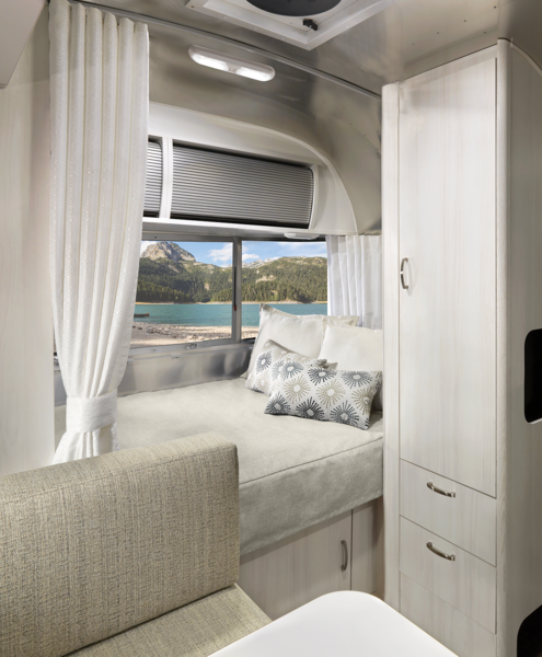 The trailer is available in four lengths (16-, 19-, 20-, and 22 feet) and all include a dedicated bed with mattress that's made to fit the curve of the Airstream, and a privacy curtain.