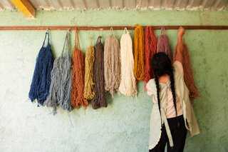 An artisan hangs dyed threads in Oaxaca that will make up MINNA's new textile collection.