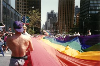 A rainbow flag going up 1st Ave.