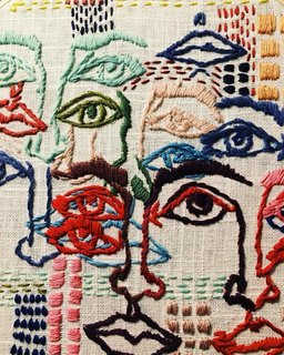 A close up of Tessa Perlow's embroidered faces.