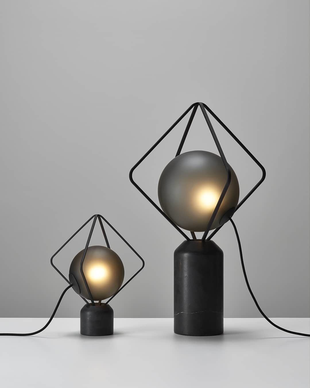 """Designed by Lucie Koldova, these lamps are part of Brokis'  Jack O'Lantern collection with a marble base, metal frames, and a handblown, acid-etched glass """"pearl  Photo 9 of 12 in 12 Lighting Designers You Should Follow on Instagram Right Now"""