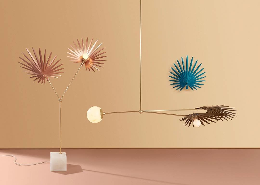 Rosie Li's INEZ collection is inspired by the forests of Yucatán, reflecting the natural architecture and structural folds of a fan palm. Copper shades with salt patinas are hand-pleated and balanced with rounded alabaster counterweights.  Photo 2 of 12 in 12 Lighting Designers You Should Follow on Instagram Right Now