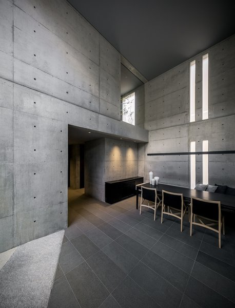 A single Japanese red pine tree provided the impetus to build this spartan, three-story dwelling and office designed by architect Go Fujita of Gosize in Nishinomiya, known as a prime site for Japanese cherry blossom sightings. Fashioned almost entirely of concrete, it has high ceilings and full walls that make way for select materials including tin, oak, and silver foil.